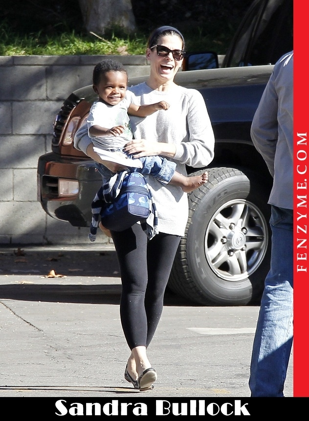 Sandra Bullock Picks Up an Excited Little Louis