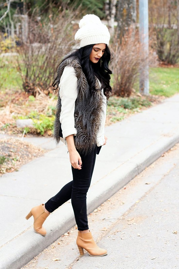 The long sleeves of the dress and the faux fur vest are a plus for the transitioning weather, but the light color of the vest, the floral pattern of the dress, and its length are perfect for a spring look.