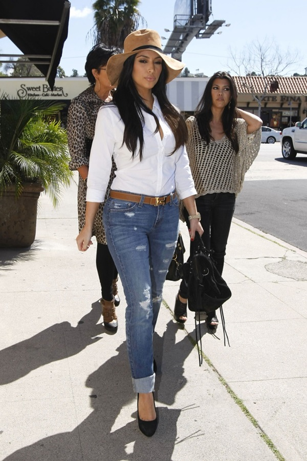 "53372, LOS ANGELES, CALIFORNIA - Friday April 8, 2011. Kourtney and Kim Kardashian, along with Bruce and Kriss Jenner, leave Stanley's restaurant with a camera crew as they film for their reality TV show ""Keeping Up with the Kardashians"". Kim was wearing a white button up shirt, large brimmed hat and ripped blue jeans while her sister Kourtney sported a loosed, macrame top and skinny black jeans. Bruce and Kris were spotted having a laugh together as they drove off in their SUV. Photograph: Nathanael Jones, © PacificCoastNews.com **FEE MUST BE AGREED PRIOR TO USAGE** **E-TABLET/IPAD & MOBILE PHONE APP PUBLISHING REQUIRES ADDITIONAL FEES** UK OFFICE:+44 131 557 7760/7761 US OFFICE:1 310 261 9676"