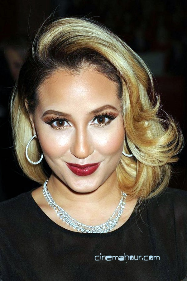 ADRIENNE BAILON at The Heart Truth 2013 Fashion Show in New York