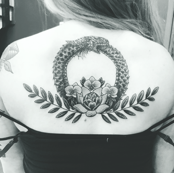 Beautiful Ouroboros Tattoo Ideas with Meanings10